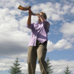 Jo Booser blowing the shofar