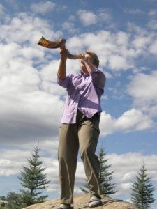 Jo Booser blowing the shofar